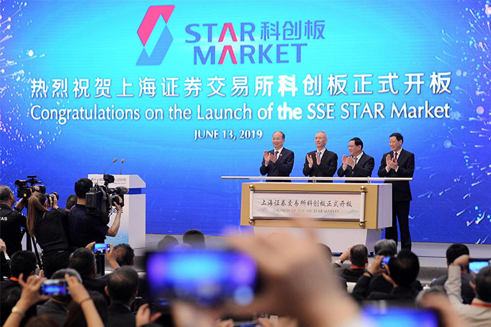 Officials applaud the launch of the Shanghai Stock Exchange's new high-tech board, the SSE STAR Market, on Thursday in Shanghai. Photo: VCG