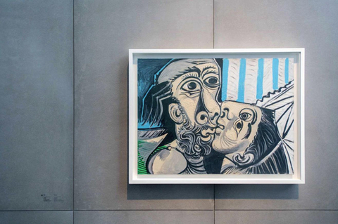 "Pablo Picasso's painting ""The Kiss"" hangs on display at the UCCA Center for Contemporary Art in Beijing. The exhibit, which features 34 for the Spanish master's paintings, opened Saturday and runs until Sept. 1. Photo: UCCA"