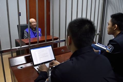 Zhang Xiaolei is questioned by police on Jan. 14, 2018. Photo: VCG