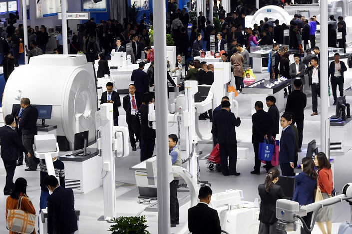 People attend a medical-device fair in Kunming, Yunnan province, on Oct. 30, 2017. Photo: VCG