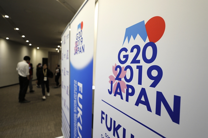Banners for the G-20 meeting of finance ministers and central bank governors stand outside the meeting's media center in Fukuoka, Japan, on June 8. Photo: VCG