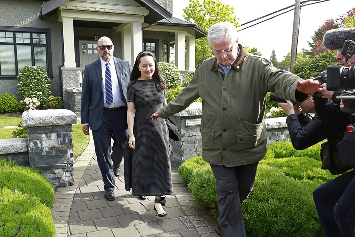 Huawei Chief Financial Officer Meng Wanzhou wears an electronic monitoring device on her ankle as she is escorted by security from her home in Vancouver, Canada, on May 8.  Photo: VCG