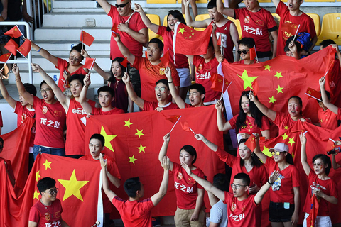 Chinese football fans cheer on Tuesday. Photo: VCG