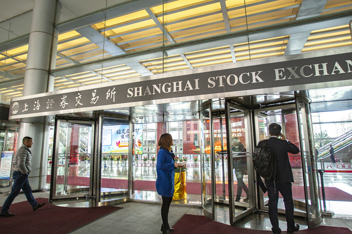 People enter the Shanghai Stock Exchange on March 8. Photo: VCG