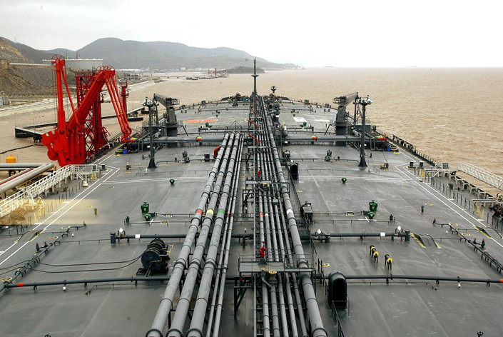 Imported crude oil gets offloaded at a terminal at the port of Ningbo in eastern China on Jan. 9. Photo: VCG
