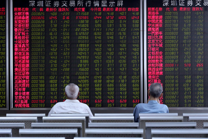 Investors watch stock prices change at a brokerage in Beijing on Tuesday. Photo: IC Photo