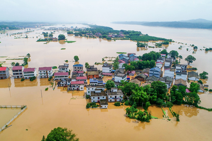 Homes and fields submerged by floodwater in Xiajiang county, East China's Jiangxi province on June 10. Photo: IC Photo