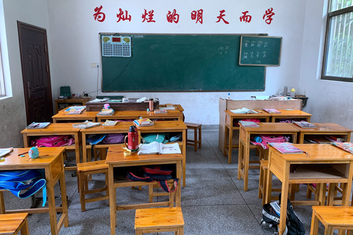 "Tianquan village primary school, which has just one teacher, caters to the more than 100 local families. The village is a 30-minute drive from the Wuyuan county seat. Most of the school-age children are so-called ""left-behind children,"" whose parents have left their rural homes to find work in bigger cities. Photo: Shen Fan/Caixinc"