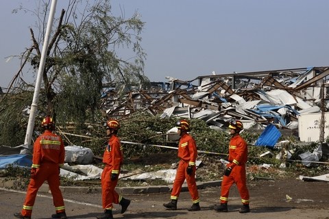 A rescue team searches for victims in debris. Photo: IC Photo