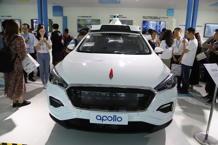 Visitors to Baidu's Create AI conference view an autonomous car built by the search engine company and carmaker Hongqi in Beijing on July 3. Photo: VCG