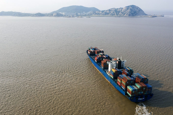 Dealmakers say trade tensions between the U.S. and China, which have brought rising tariffs, have clearly affected the pace of acquisitions. Photo: Bloomberg