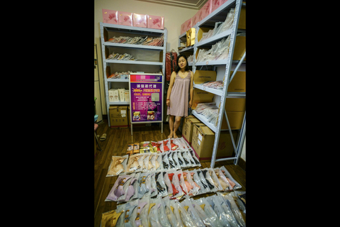 A distressed Weishang user stands next to a large volume of underwear she purchased but has been unable to sell. Photo: VCG