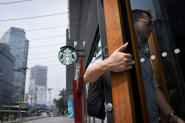 A customer walks into a Starbucks in Beijing on Aug. 2. Photo: VCG