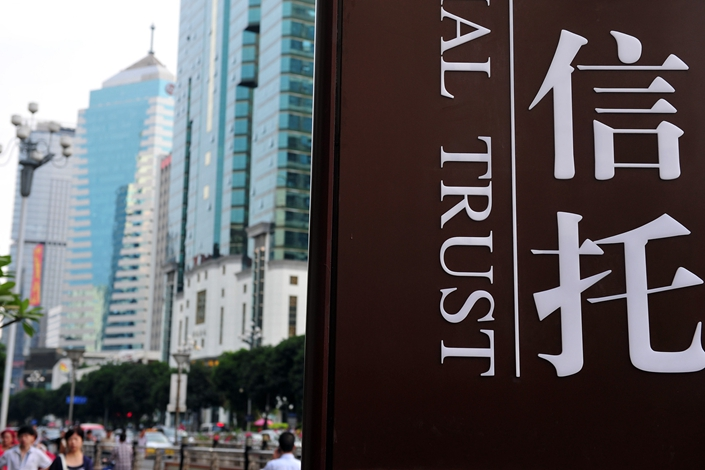 Several trust firm managers summoned to meet with financial regulators said they were ordered to put an end to any illegal funding to property developers, such as lending to developers before they obtain land-use permits. Photo: VCG