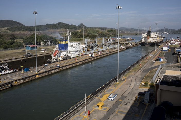 Low water levels caused by a drought this year have forced the Panama Canal's authority to restrict the size of vessels allowed to cross the new set of locks. Photo: Bloomberg