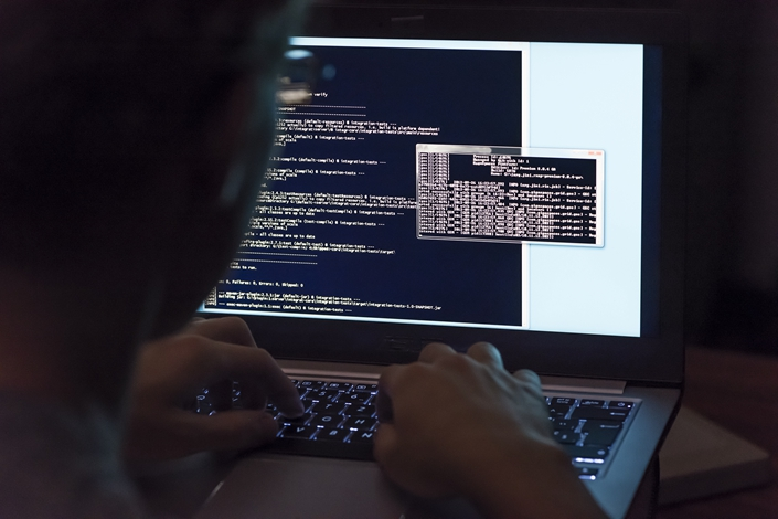 A former broker of Guotai Junan Securities Co. Ltd., who hacked into computer systems of several government bodies, brokerages and futures companies, was sentenced to five years and two months and fined 20,000 yuan for illegal invasion of computer system and infringing on citizens' personal information. Photo: VCG