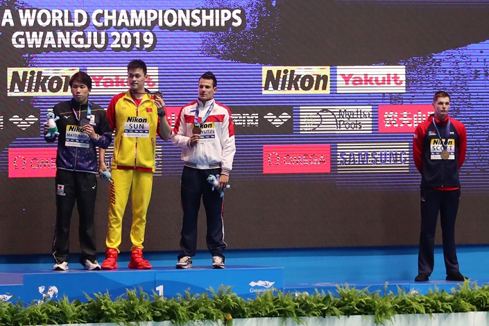 British bronze medalist Duncan Scott, right, refuses to stand with gold medalist Sun Yang, second left, as Japanese silver winner Katsuhiro Matsumoto, left, and Russian joint bronze medal winner Martin Malyutin pose on the podium following the men's 200 meter freestyle final at theWorld Aquatics Championships  in Gwangju, South Korea, on July 23. Photo: VCG