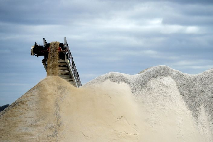 Lithium ore falls from a chute onto a stockpile at the Bald Hill lithium mine outside Widgiemooltha, Australia, on Monday, Aug. 6, 2018.