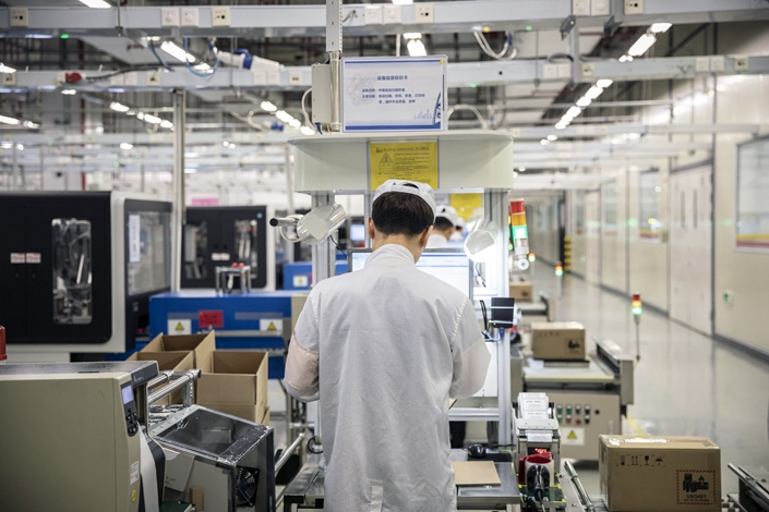 July has more working days than June, which could also have helped lift production. Photo: Bloomberg