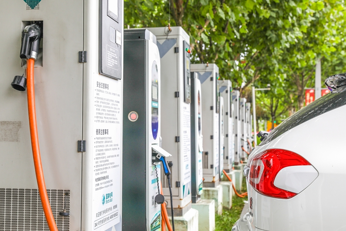 A new-energy vehicle charging station in Shanghai in July. Photo: VCG