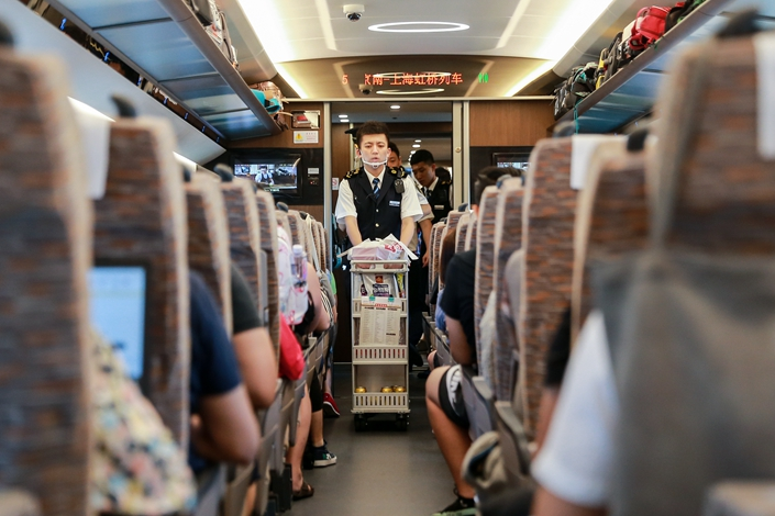 Railway staff delivery food to passengers on a high-speed train near Nanjing, Jiangsu province, on July 21. Photo: IC Photo
