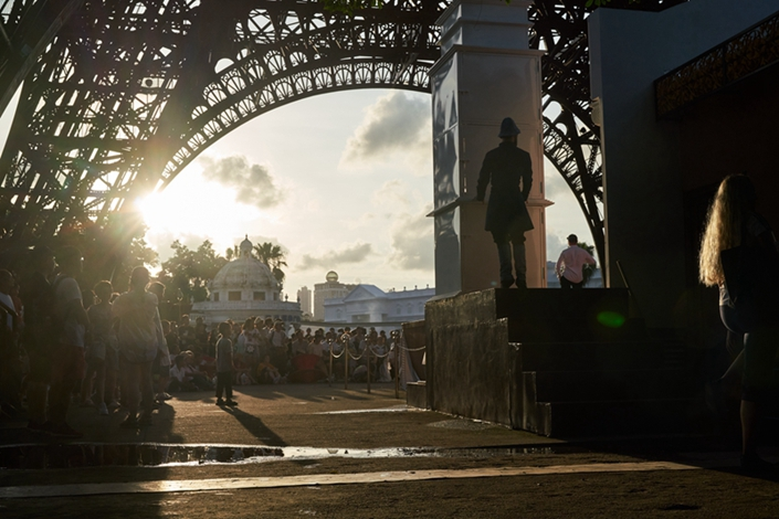A dancer from Georgia prepares to stage a performance under the shadow of a mock Eiffel Tower at the Window of the World, a theme park in Shenzhen featuring replicas of international tourist attractions. Employees are expected to perform a variety of dances from different cultures a few times a day. Photo: Liang Yingfei/Caixin
