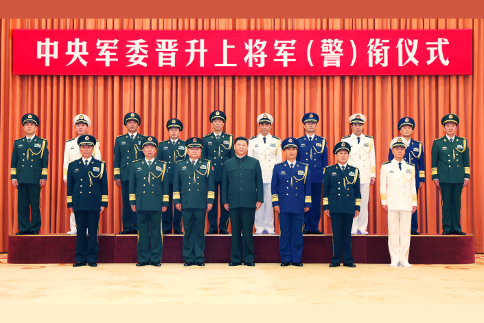 Chinese President Xi Jinping (front center), also chairman of the Central Military Commission, and other military leaders pose for a group photo with 10 newly promoted generals in Beijing, on July 31. Photo: Xinhua