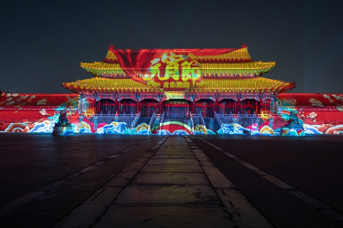 A building in Beijing's Forbidden City is lit up during the Lunar New Year holiday in February. The light show was reportedly assisted by Appotronics. Photo: VCG