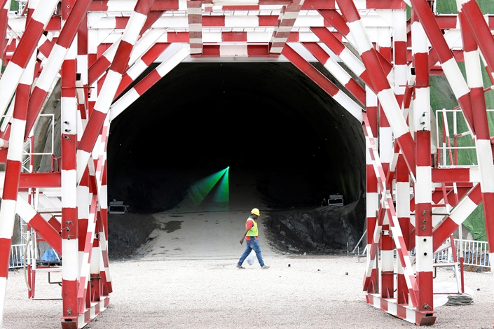 A worker walks past a tunnel that forms part of the East Coast Rail Link project in Dungun, Terengganu, Malaysia, on July 25. Photo: VCG