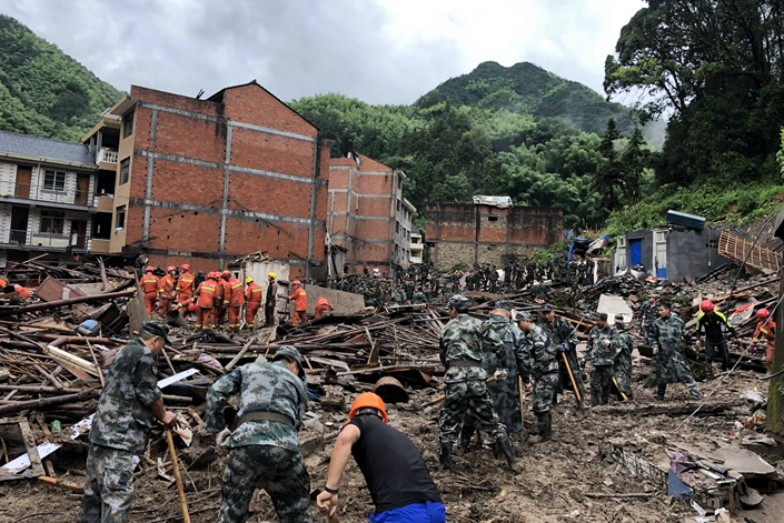 Rescue workers deal with the aftermath of a landslide that hit Yongjia, East China's Zhejiang province, on Saturday. Photo: IC Photo