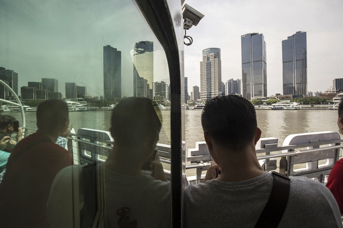 Passengers take a ferry across the Huangpu River in Shanghai in June 2018. Photo: Bloomberg