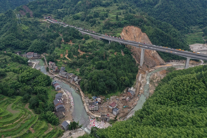 Collapsed buildings can be seen along the river Sunday in Shanzao village in Wenzhou, East China's Zhejiang province. Photo: VCG