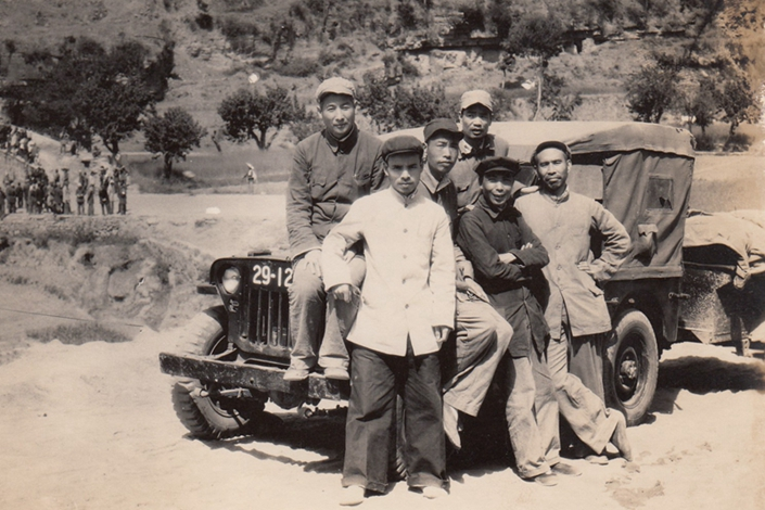 Gu Xiaoyang's father (back row, center) sits on a jeep in Yangcheng county, Shanxi province, March 1949. Photo: Courtesy of Gu Xiaoyang