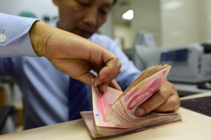New social financing in July came in below market expectations, and the strengthening of financial supervision and deleveraging on small and midsize banks could have the side effect of further increasing financing costs for small and midsize enterprises. Photo: VCG
