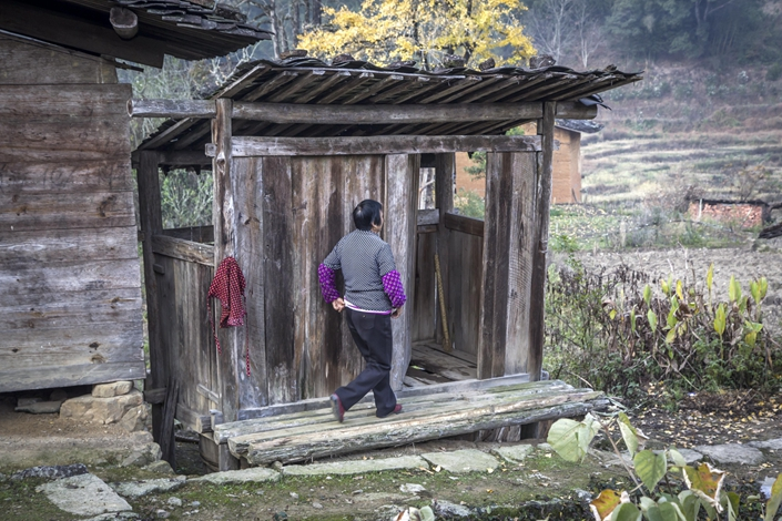 A villager heads into an outhouse toilet in Youxi county in East China's Fujian province in December 2017. Photo: VCG