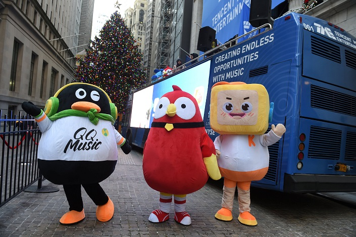 Mascots of Tencent Music Entertainment celebrate the company's IPO outside the New York Stock Exchange in New York, Dec. 12, 2018. Photo: VCG
