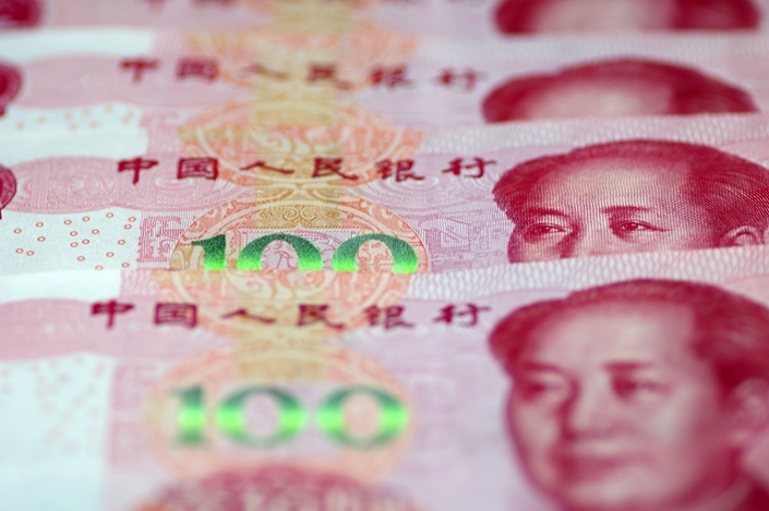 The PBOC's decision to let the yuan weaken beyond 7 yuan per dollar represents an important step toward reforming China's inflexible exchange rate regime. Photo: IC Photo
