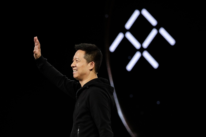Jia Yueting waves during the unveiling of Faraday Future's FF91 electric car at CES International 2017, in Las Vegas.
