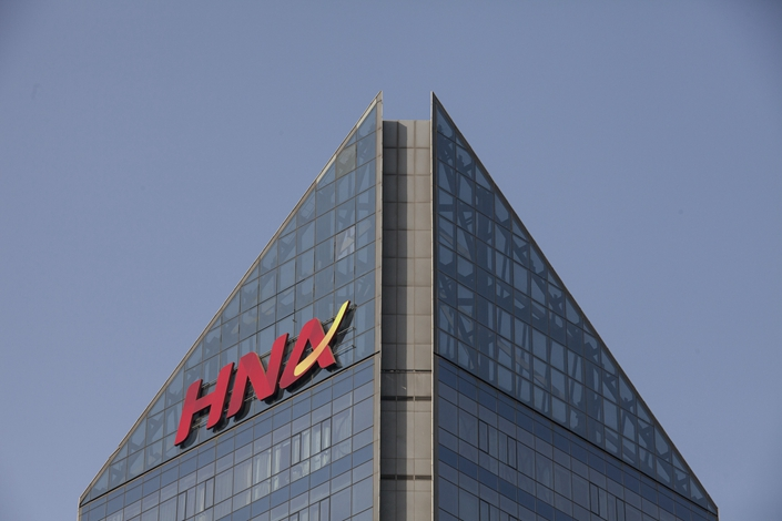 Signage for HNA Group Co. is displayed atop the company's building in Beijing, on Feb. 1, 2018. Photo: Bloomberg