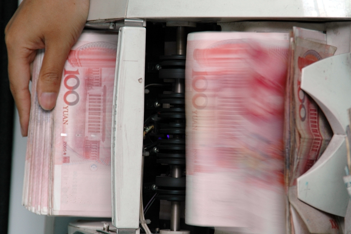 China has cut banks' reserve requirement, releasing $126 billion. Photo: IC Photo