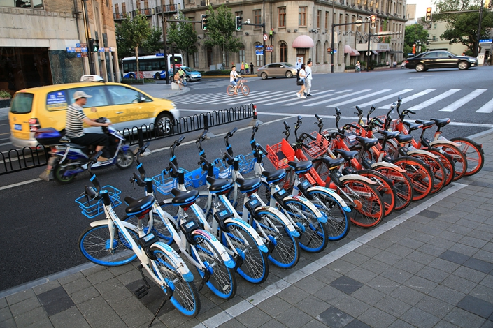 Shared bikes stand in a neat row on a Shanghai sidewalk on Aug. 2. Photo: VCG