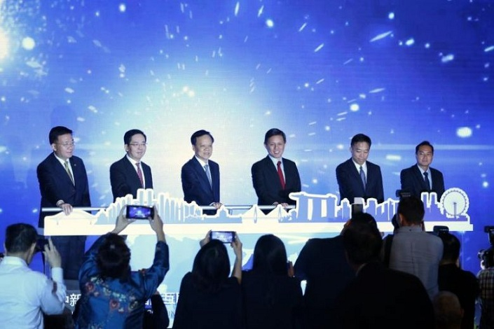 Singapore's Minister for Trade and Industry Chan Chun Sing (third from right) and Chongqing Party Secretary Chen Min'er (third from left) appear at the launch of the China-Singapore (Chongqing) International Data Channel on Wednesday. Photo: The Straits Times