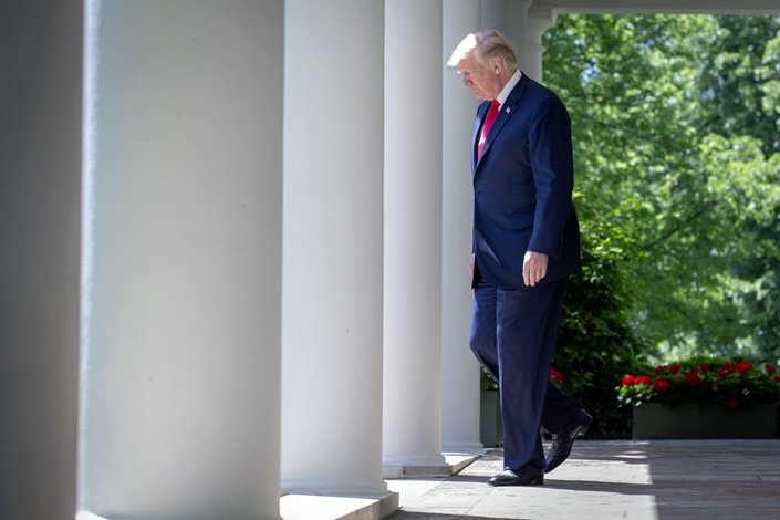 United States President Donald J. Trump walks along the colonnade outside the Oval Office prior to a National Day of Prayer event in the Rose Garden at the White House in Washington, DC on May 3, 2018. Photo: Bloomberg