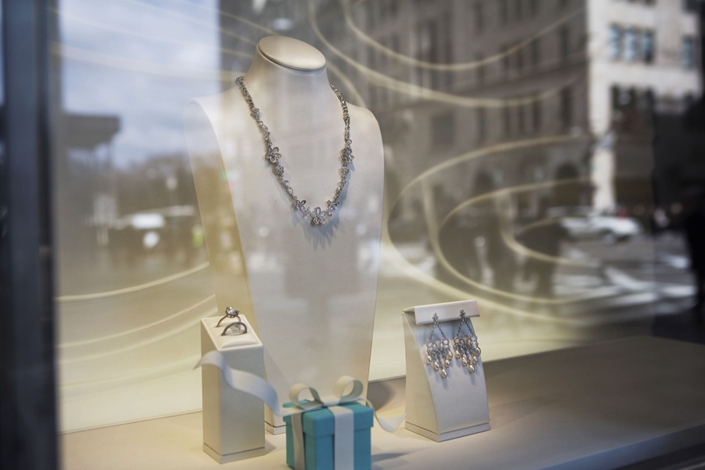 Jewelry is displayed in the window of Tiffany & Co. on Fifth Avenue in New York, March 18, 2015.
