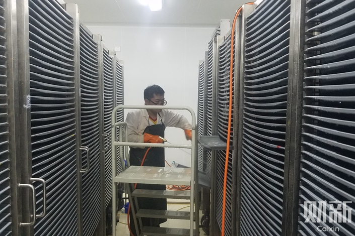 """The world's largest """"mosquito factory"""" is hidden in a nondescript building in Guangzhou. The 3,500 square meter lab hatches millions of mosquitos each week for use in control efforts. Photo: Liu Denghui/Caixin"""