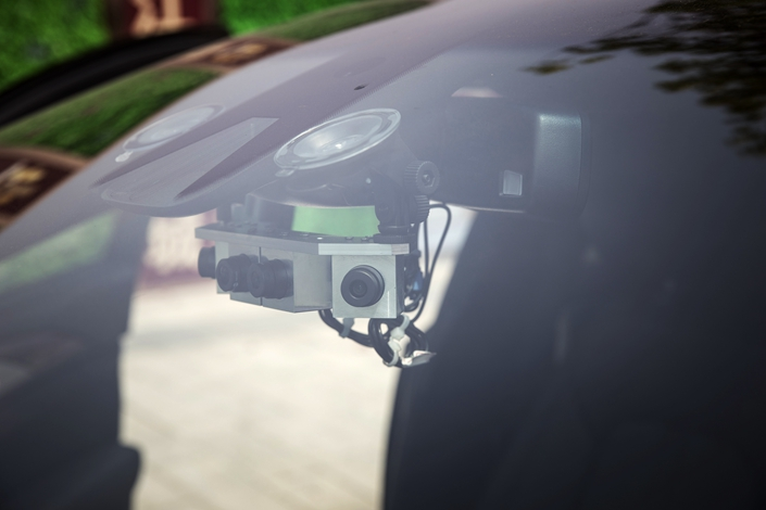 Cameras for SenseTime Group Ltd.'s autonomous driving system are mounted inside a Lincoln Motor Co. MKZ sedan during a test-drive in Hangzhou, East China's Zhejiang province, on Sept. 6.  Photo: Bloomberg