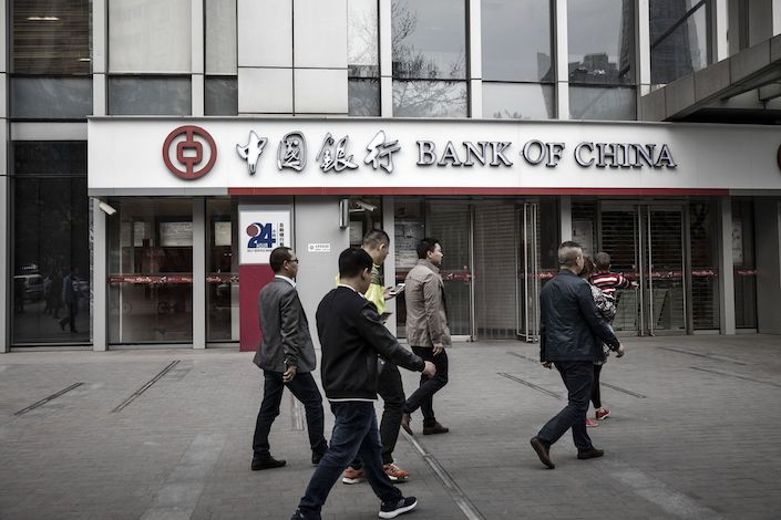 Pedestrians walk past a Bank of China branch in Chengdu. Photo: Bloomberg