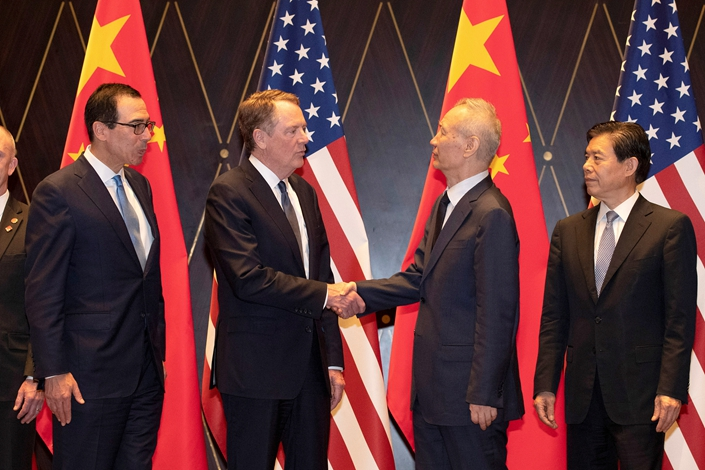 U.S. Trade Representative Robert Lighthizer shakes hands with Chinese Vice Premier Liu He as U.S. Treasury Secretary Steven Mnuchin and China's Commerce Minister Zhong Shan look on at the Xijiao Conference Center in Shanghai, July 31. Photo: VCG