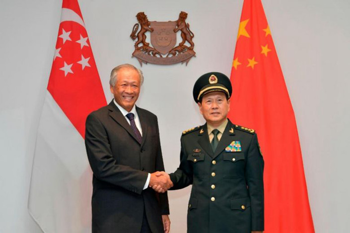 Singapore's Defence Minister Ng Eng Hen (left) meets China's Defence Minister Wei Fenghe on May 29 in Singapore. Photo: Ministry of Defence