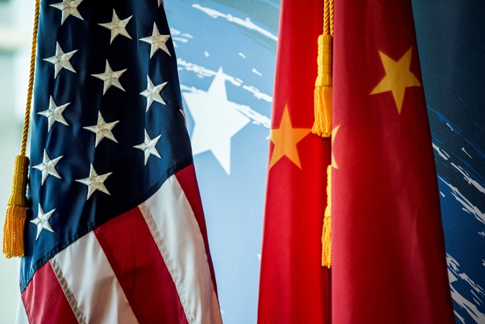 The Chinese and US national flags are seen during a promotional event in Beijing